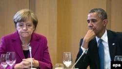 """Ангела Меркель и Барак Обама во время саммита """"Большой семерки"""" в Брюсселе 4 июня 2014 года"""