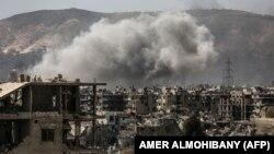 Сириядагы уруштан талкаланган үйлөр.
