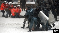 Ukrainian riot police arrest protesters in the center of Kyiv during clashes on January 22.