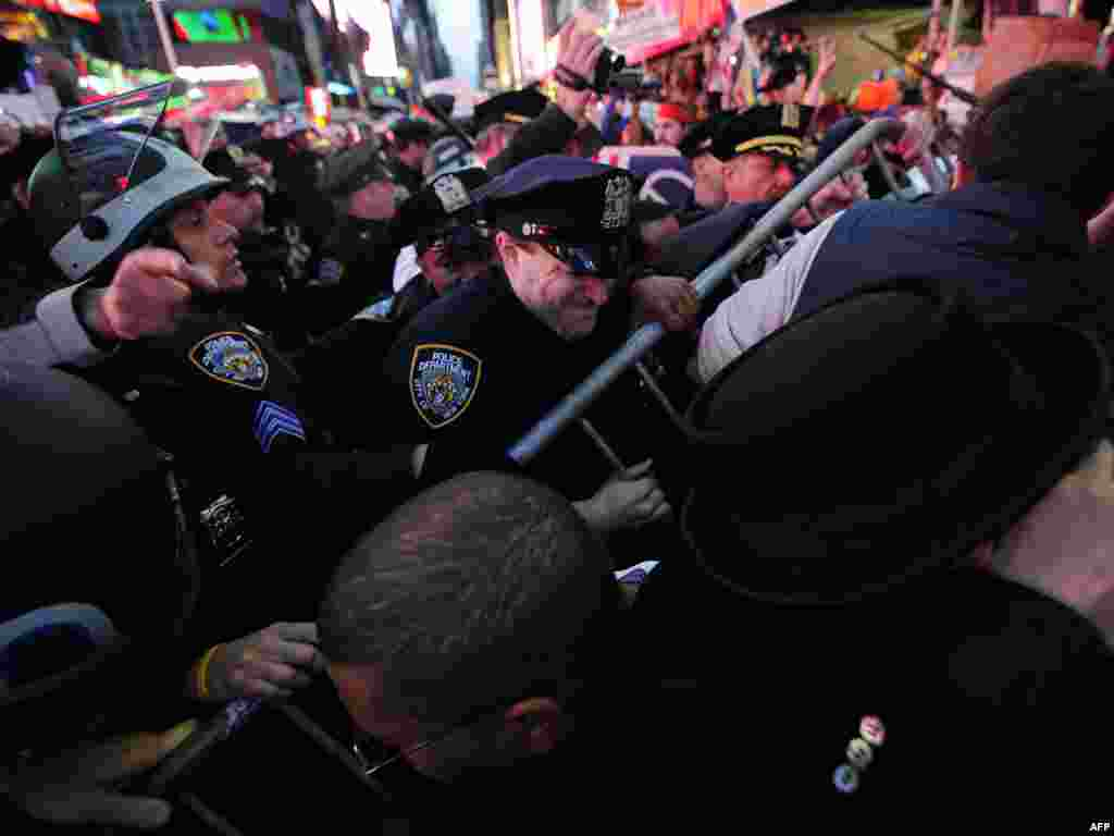 "U.S. -- police defend barricades as ""Occupy Wall Street"" protesters march in Times Square in New York City on 15oct2011"