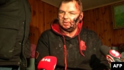 A TV grab made on January 31 and taken from a same-day broadcast by Ukrainian Channel 5 television shows Ukrainian opposition activist Dmytro Bulatov being interviewed in Kyiv.