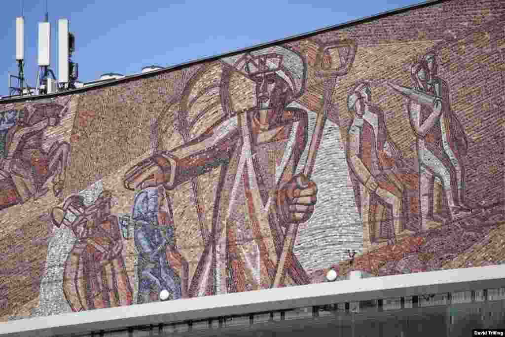 A detail from a mosaic celebrating the Soviet Union's workers, on Moscow's Oktyabr Theater.