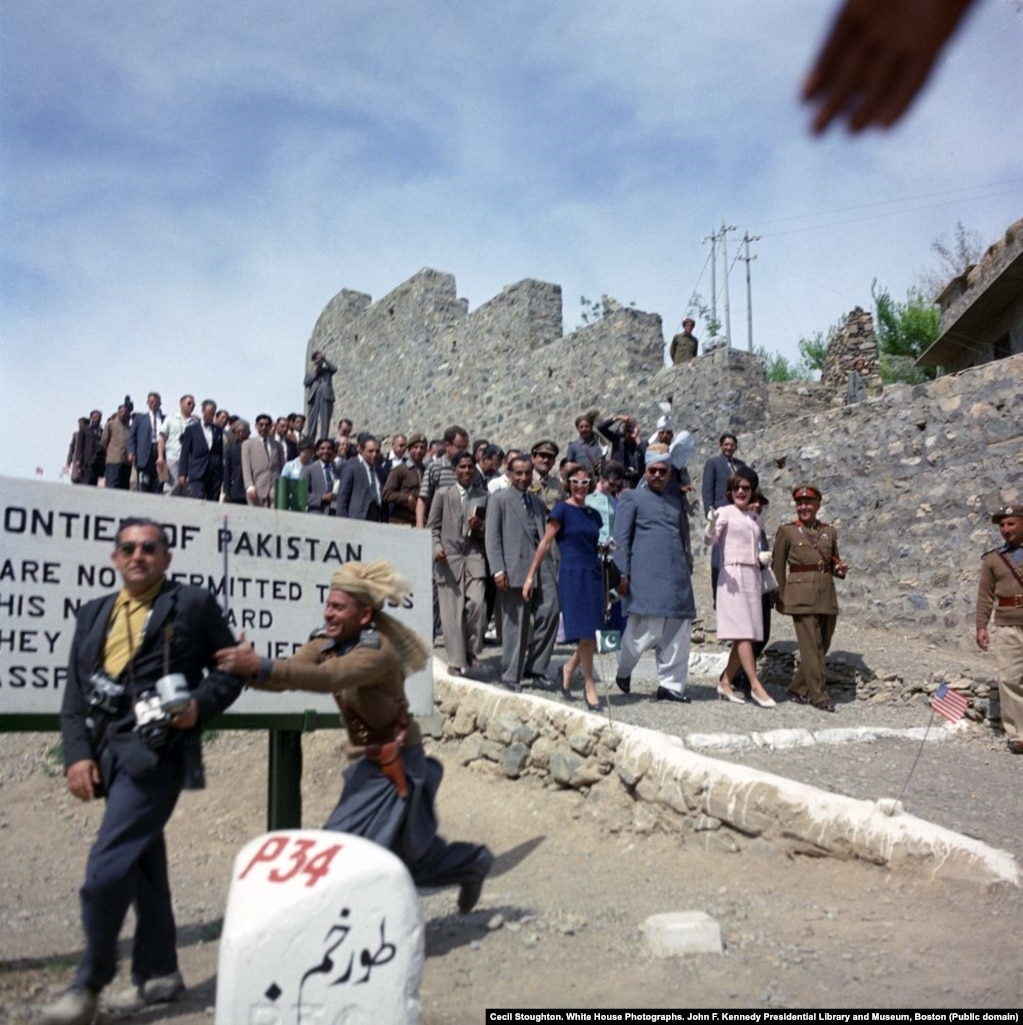 """The first lady visits the Khyber Pass, near the Pakistan-Afghan border. During this outing, Clint Hill says tribesmen intended to """"sacrifice"""" a lamb in front of the animal-loving first lady as a sign of respect. Hill intervened and ordered a colleague to """"guard that lamb with your life"""" until Kennedy had left."""