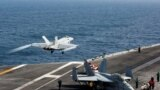 Американ хӀаваан тIеман кеманаш тIехь долу тIеман хIордан кема (aircraft carrier)