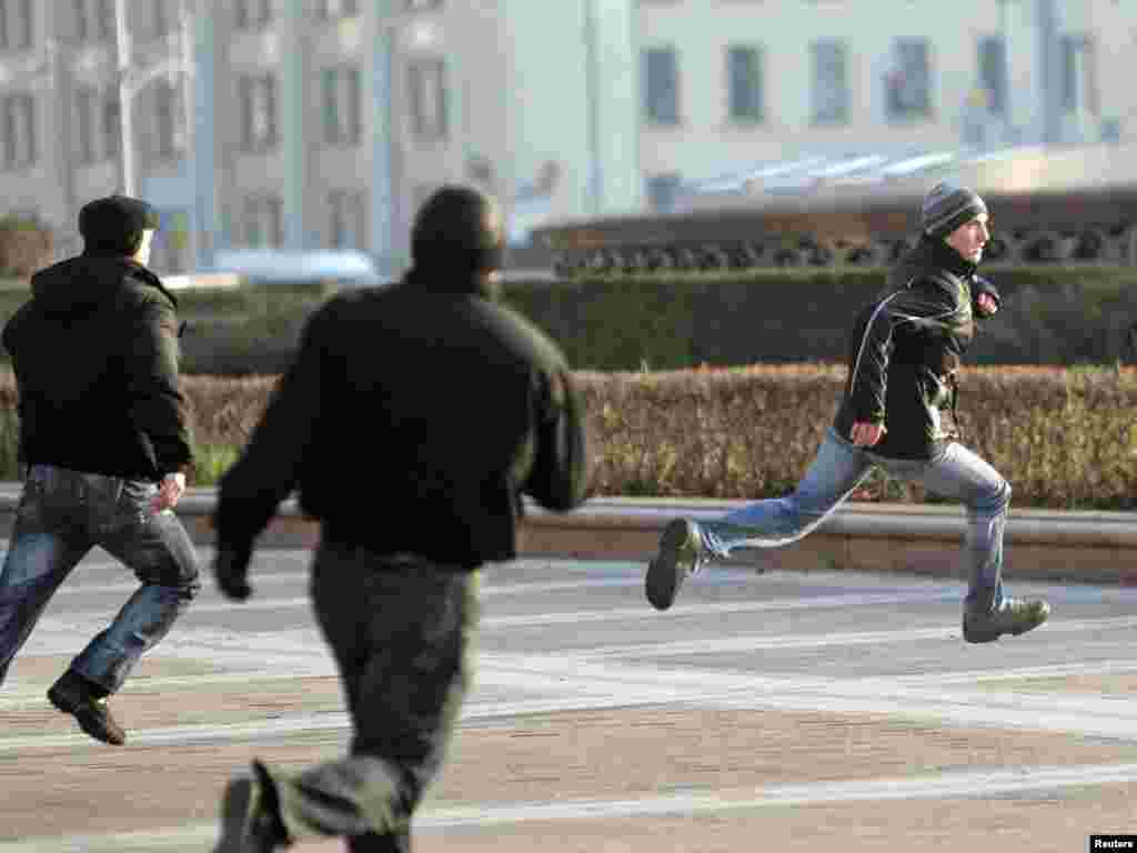 Belarusian police in plain clothes chase a protester on Independence Square in Minsk. Several dozen people gathered in Minsk on November 7 to mark Revolution Day, commemorating the 1917 Bolshevik Revolution. (Photo for Reuters by Vasily Fedosenko)