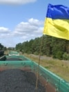 A Ukrainian national flag is seen as activists block a train carrying coal from Russia at the Seletz-Zavone railway station in the Lviv region on September 17.