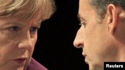 Angela Merkel dhe Nikolas Sarkozi