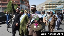 FILE: Afghan peace activists shout slogans in demand to an end to the war during a march from Helmand as they arrived in Kabul in June.