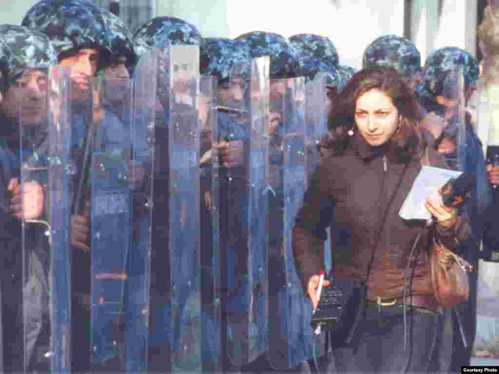 RFE/RL Armenian Service correspondent Ruzanna Stepanyan at the postelection protests in Yerevan - RFE/RL Armenian Service correspondent Ruzanna Stepanyan on March 1 in front of the French Embassy, just before clashes broke out between police and demonstrators protesting the February 19 presidential election, in which opposition candidate Levon Ter-Petrossian lost to Prime Minister Serzh Sarkisian. A state of emergency was declared in Yerevan later in the day on March 1.