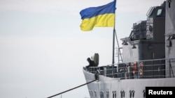 "A Ukrainian Navy sailor stands guard on the ""Slavutych"" flagship in Sevastopol on March 18. The ship was seized by pro-Russian forces four days later."