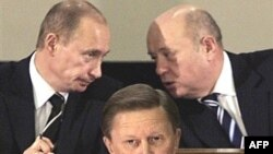 Putin (left) and Mikhail Fradkov chat while Sergei Ivanov gives a speech in 2006.