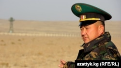 A Kyrgyz border guard stands watch in Batken Province on the country's frontier with Uzbekistan and Tajikistan.