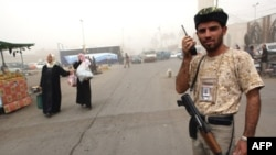 An armed member of a so-called Awakening Council in central Baghdad (file photo)