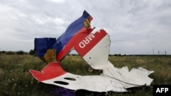 A piece of wreckage from Malaysia Airlines Flight MH17 is seen in Shaktarsk, Ukraine, on July 18.