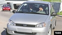 Russian President Vladimir Putin drives a Lada Kalina automobile while visiting the AvtoVAZ plant in Tolyatti in 2007.