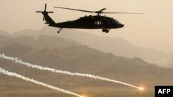 A U.S. Army Blackhawk helicopter flies in Afghanistan's Kandahar Province on March 25.