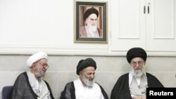 Supreme Leader Ayatollah Ali Khamenei, right, at a meeting with top clerics in the holy Shi'ite city of Qom.