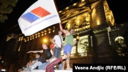 Serbs celebrate nationalist Tomislav Nikolic's election as president in Belgrade on May 20.