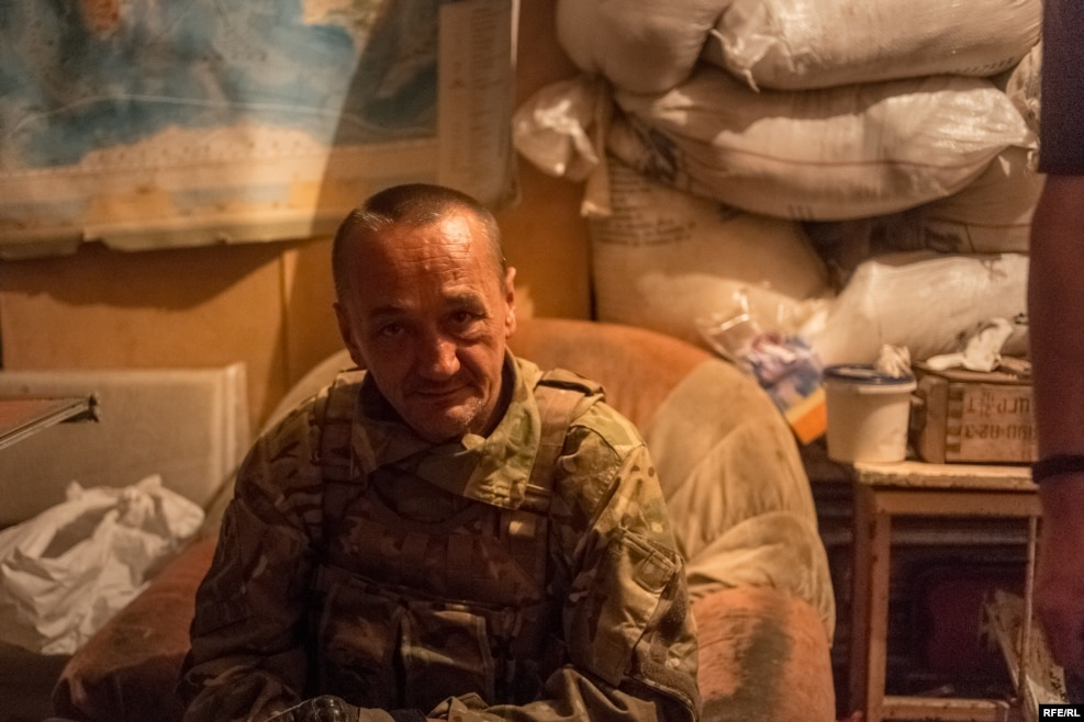 """Prom"" is a 51-year-old former Soviet soldier. He spent 10 years in a Soviet prison for stabbing another man, but says he doesn't regret it. ""The Soviet Union was a tough place to live, and I did what I had to do to survive."" He says he has no intention of leaving the front line. ""They'll have to take me out in a body bag, because I'm not leaving this place."""