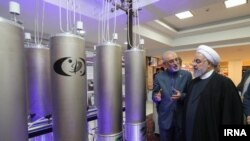 Ali Akbar Salehi, Iran's nuclear chief with President Hassan Rouhani inspecting a nuclear fcility. Apr 9, 2019