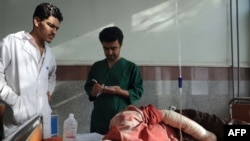Medical staff tend to an injured civilian at a hospital in Herat on September 29.