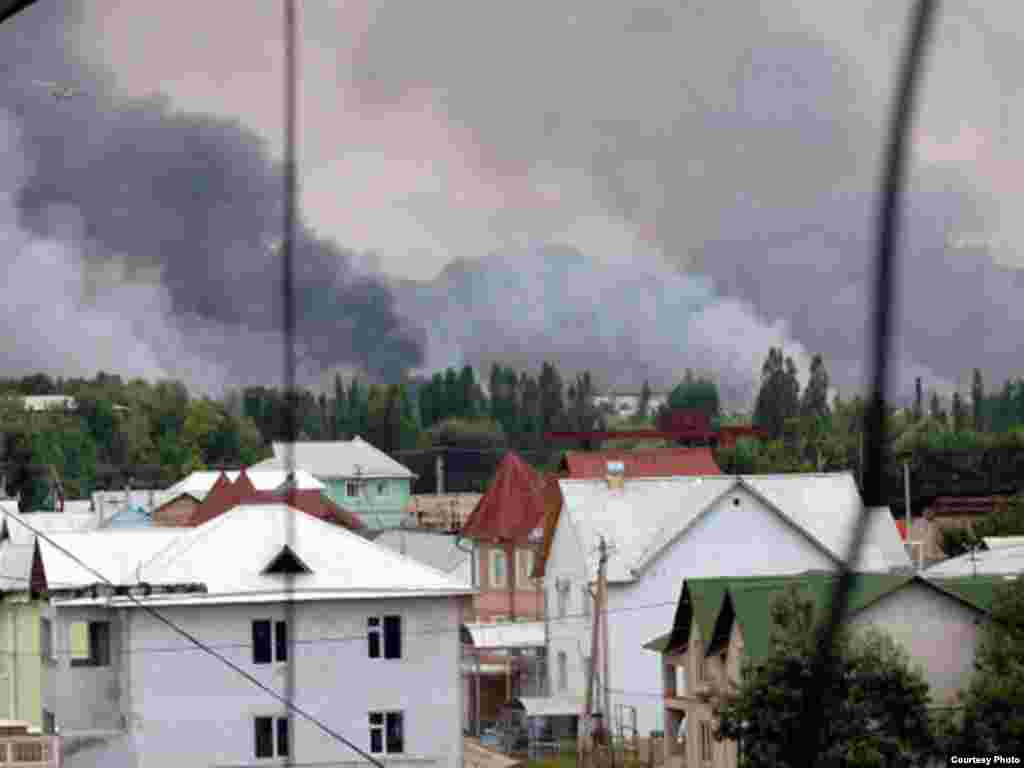 Plumes of smoke rise from burning buildings in Osh, southern Kyrgyzstan.