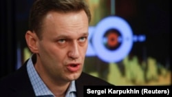 Russian opposition leader Aleksei Navalny speaks in the studio of the radio station Ekho Moskvy in Moscow on December 27.