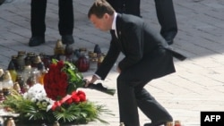 Russian President Dmitry Medvedev laid flowers at a shrine in Krakow, Poland, where a funeral mass was held April 18 for the late Polish President Lech Kaczynski and his wife, Maria.
