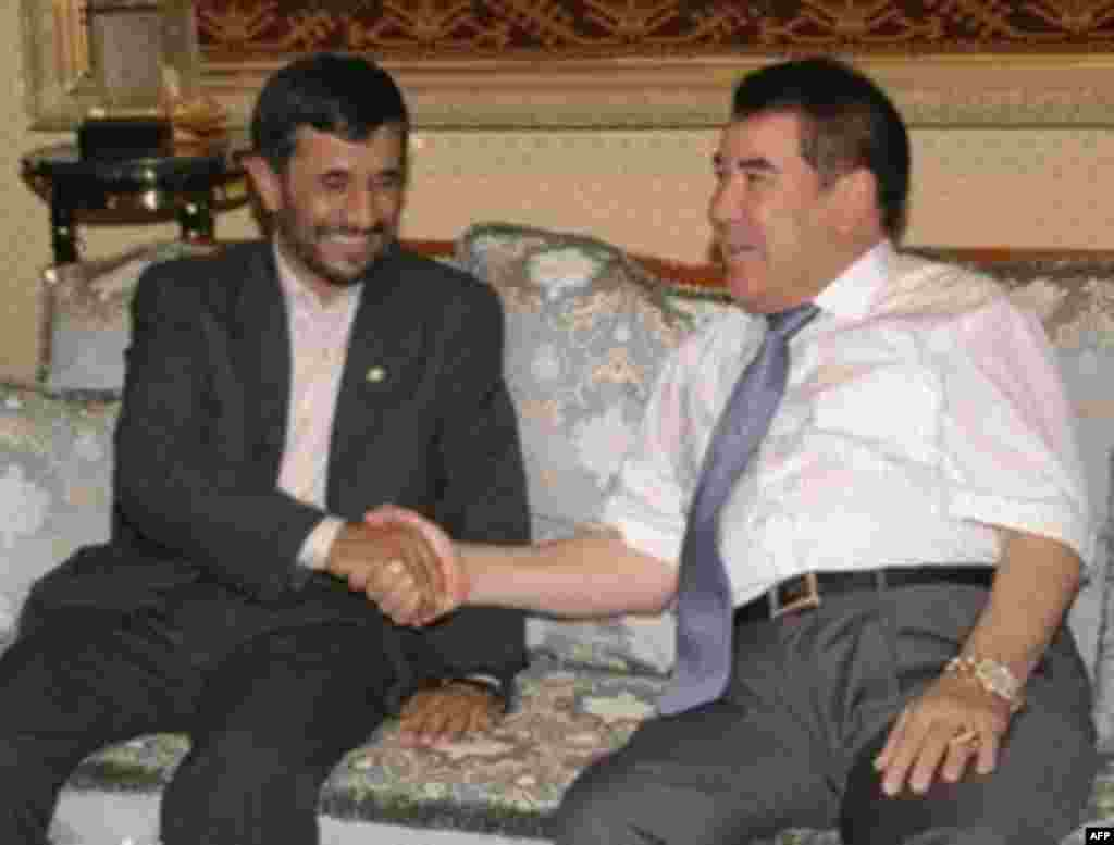Iranian President Mahmud Ahmadinejad (left) shakes hands with Niyazov prior to bilateral talks in Ashgabat in July (AFP) - Despite its general isolation from the West, the Niyazov regime was influential in Central Asia, Southeast Asia, the Caucausus, and the Middle East. There are significant Turkmen populations in Afghanistan and Iran.