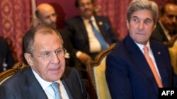 Russian Foreign Minister Sergei Lavrov (left) and U.S. Secretary of State John Kerry during a meeting in Lausanne on October 15