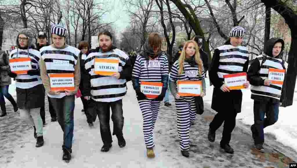 Russian opposition activists dressed as prisoners walk in central Moscow as they rally to demand freedom for political prisoners on December 1. (AFP/Andrey Smirnov)