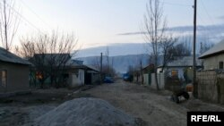 Sabzizor, Tajikistan. Without indoor plumbing, most homes have outdoor kitchens and outhouses, making small improvements or adding rooms as family members working as migrants in Russia send money home.