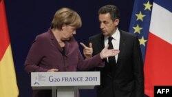 Президент Франції Ніколя Саркозі (праворуч) та канцлер Німеччини Анґела Меркель