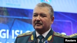 Abdusalom Azizov goes from defense minister to head the State Security Service.