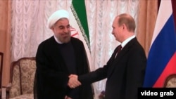 Iranian President Hassan Rohani (left) and Russian President Vladimir Putin at a recent meeting in Bishkek