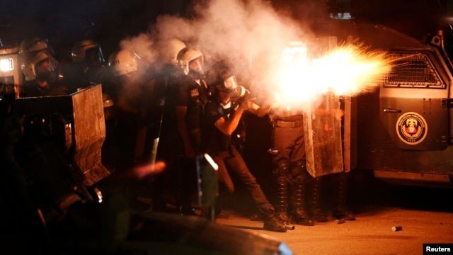 Riot police fire tear gas at protesters during clashes in Hatay.