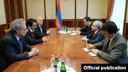 "Armenia - President Serzh Sarkisian (C,R) meets with Gagik Tsarukian (C,L), leader of ""Prosperous Armenia"" party, and the party's parliamentarians, Yerevan,10Apr,2014"