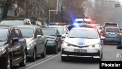 Armenia -- A police car races through heavy traffic in Yerevan, November 27, 2019.