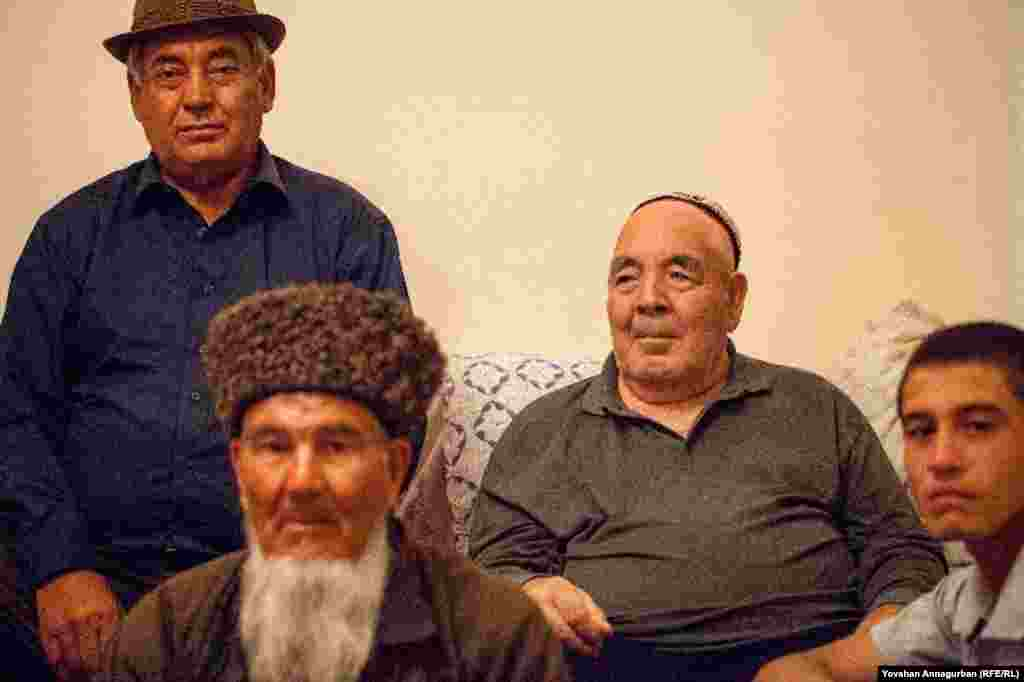 Yovshan Annagurban's father, Bashim (second from right), with fellow villagers from Dostluk. Bashim worked as a teacher for 46 years.