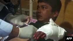 An injured student receives treatment at a Peshawar hospital following the attack.