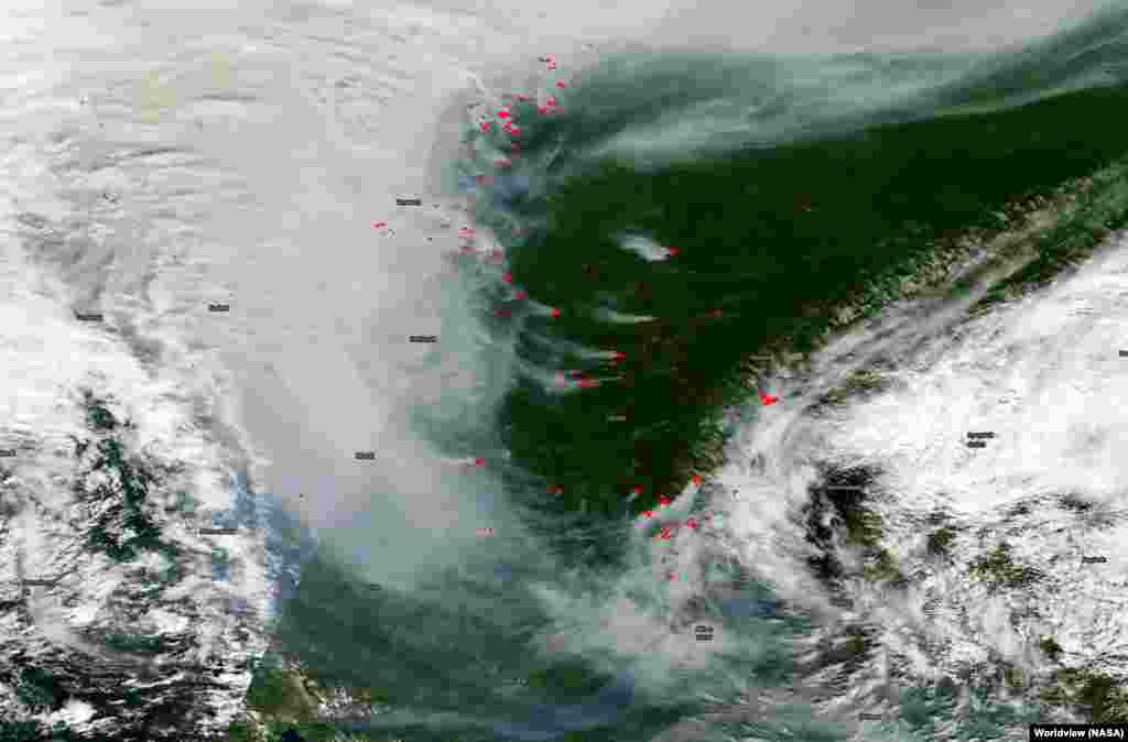 "Active fires, indicated in red, north of Irkutsk on July 25. With the fires not posing an immediate threat to people, according to The Siberian Times, the current fires are unlikely to be extinguished ""until it starts to rain extensively."""