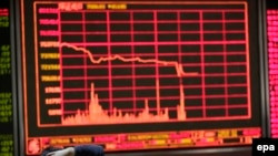 China -- A Chinese investor looks at a screen showing stock movements at a stock brokerage house in Beijing, January 4, 2016