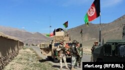 FILE: A Afghan army convoy on a major road in Kandahar Province.
