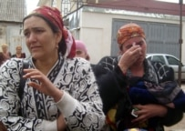 These women were among some 20 taken away by police after protesting against the demolition of their homes