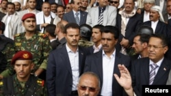 Yemeni President Ali Abdullah Saleh waves to supporters during a rally in Sanaa on April 22.