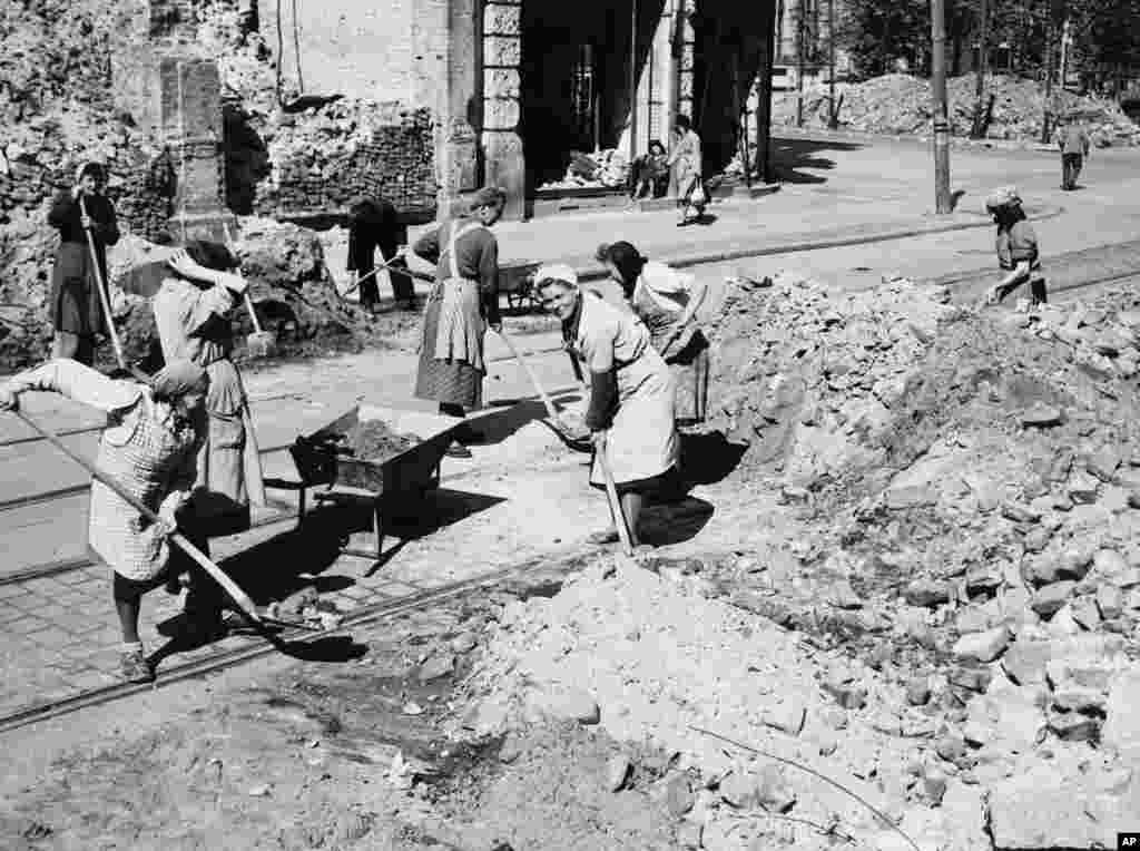 Workers in the Soviet sector of Berlin remove barricades on May 11, 1949. The blockade didn't achieve its goals, prompting the Soviet leadership to reopen the land routes between Berlin and West Germany. The Berlin Airlift continued until the end of September to stockpile fuel, food and medicine in case the Soviets restarted the blockade.