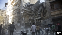 Разрушения в сирийском городе Алеппо после авиаударов.