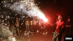 Iranians set off fireworks during the celebrations leading up to Norouz