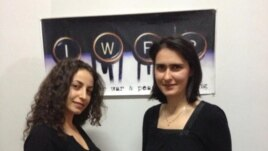 RFE/RL Armenian Service reporters Ruzanna Stepanyan (left) and Lilit Harutyunyan following the award ceremony, held at IWPR's Tbilisi office on December 3, 2012.
