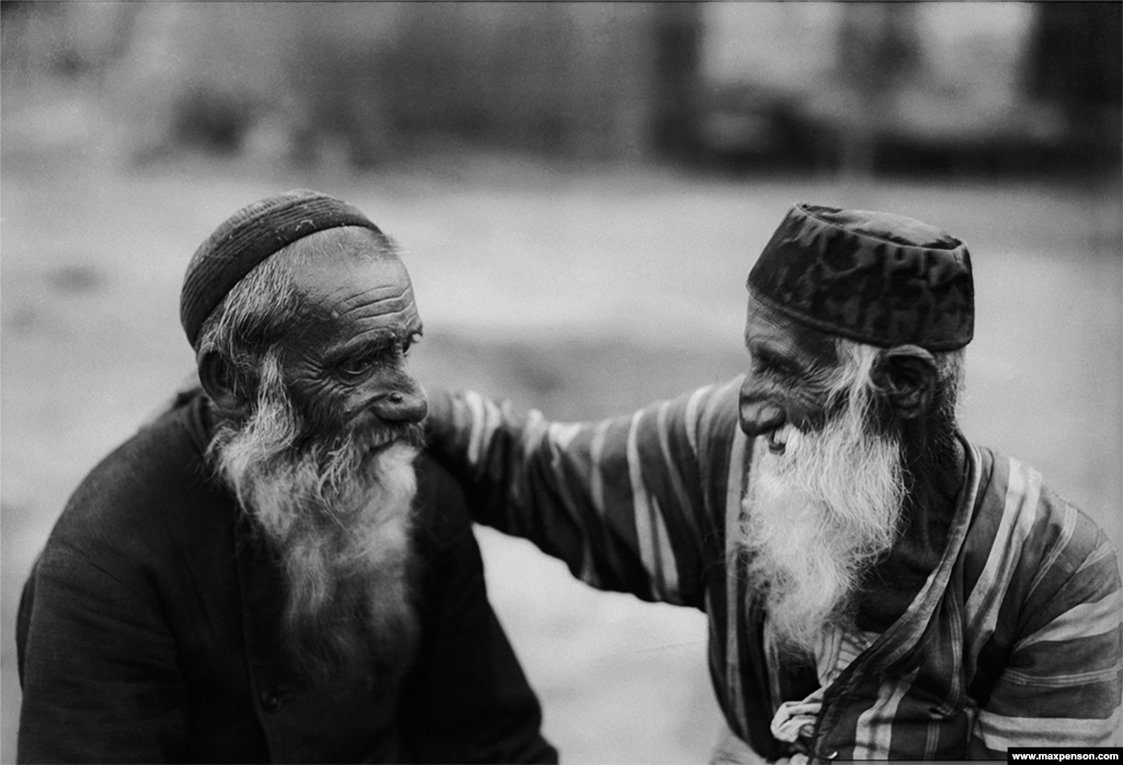 Two old Jewish men in Bukhara. Most of Penson's work was shot with 35mm film cameras, though some pictures, like this one, were shot on large-format glass plates.